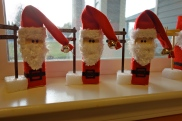 Finished Santas waiting for the photos to be attached to the direction sign by mini clothes pins.